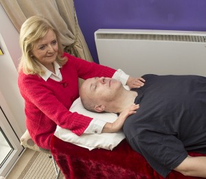 Spiritual healer Gretta treating a client in Cork